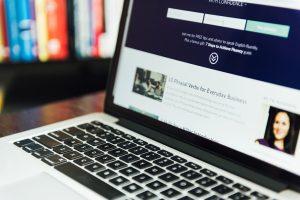 Speak Confident English Webpage on Laptop